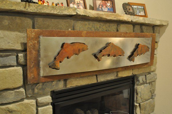 plasma cut art on fireplace surround
