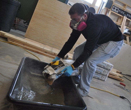 pouring-concrete-into-counter-mold