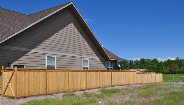 cedar-fence-on-a-slope