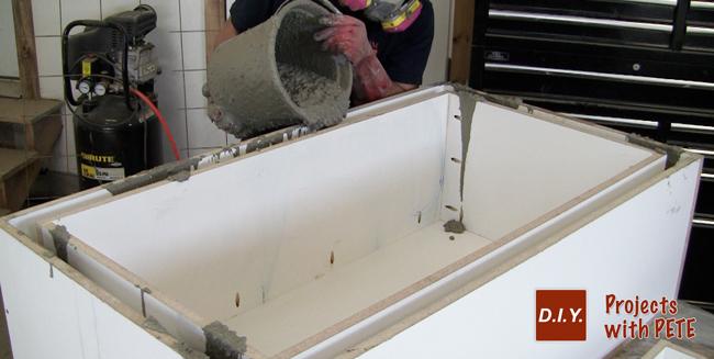 pouring-concrete-into-a-mold