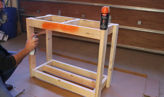 spray painting firewood storage rack