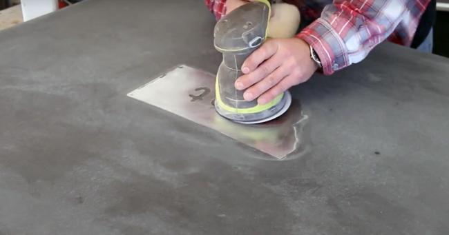 sanding metal logo