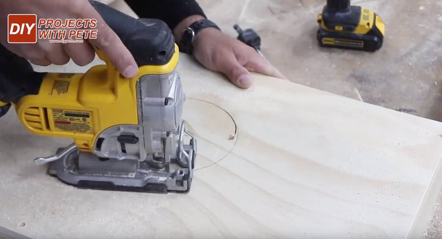 using a jig saw to make a hole in cornhole boards