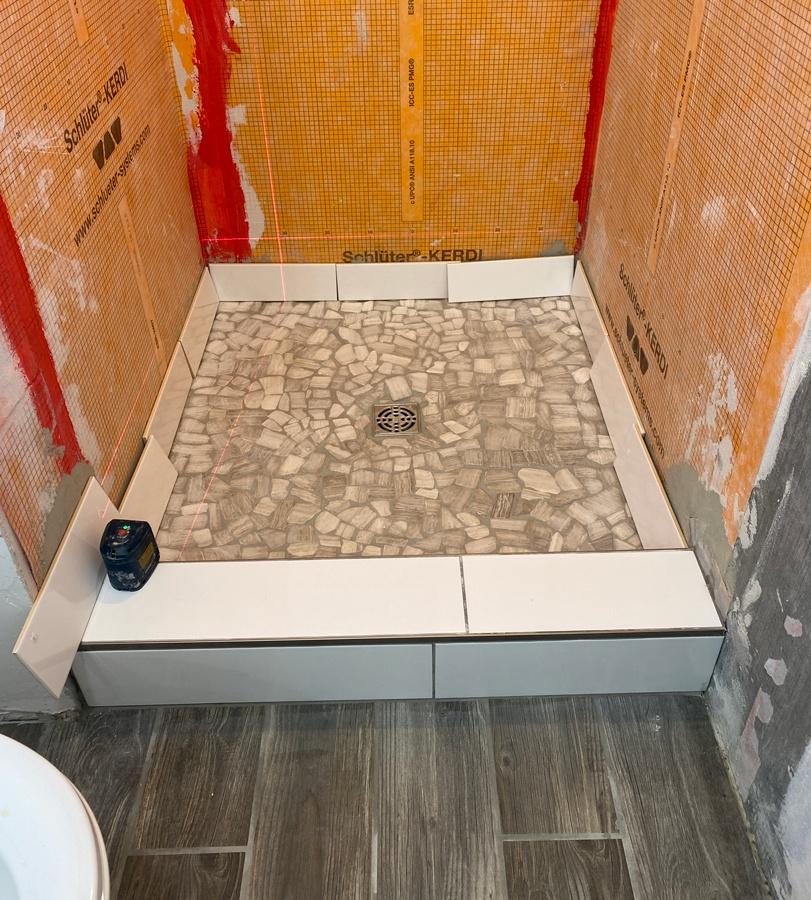 shower floor in small bathroom