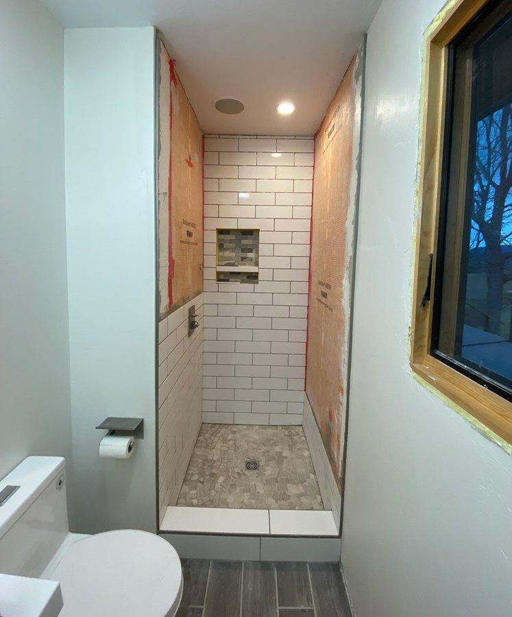 white subway tile in shower