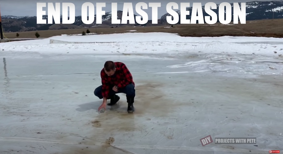 DIY Pete collecting a jar of water from last year's melted ice rink