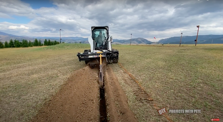 Trenching electrical lines with skid steer