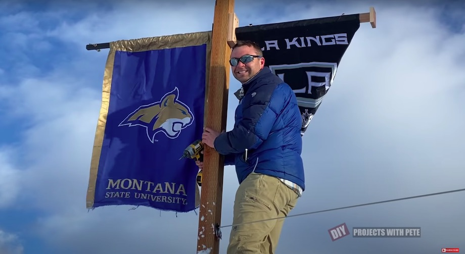Hanging team banners for Montana State University and the LA Kings