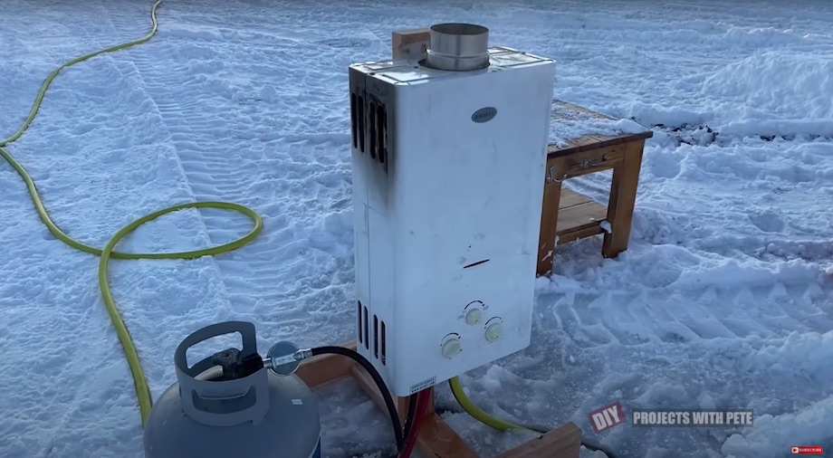 Portable hot water propane heater for a hose