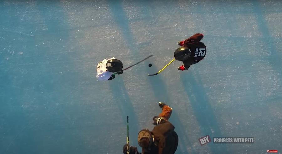 Kids faceoff puck drop on DIY outdoor hockey rink