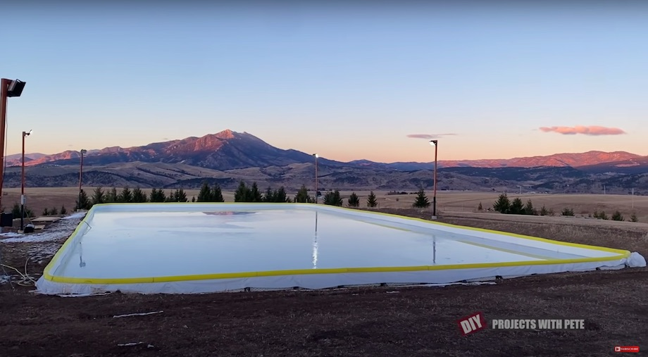 A hockey rink full of water before freezing