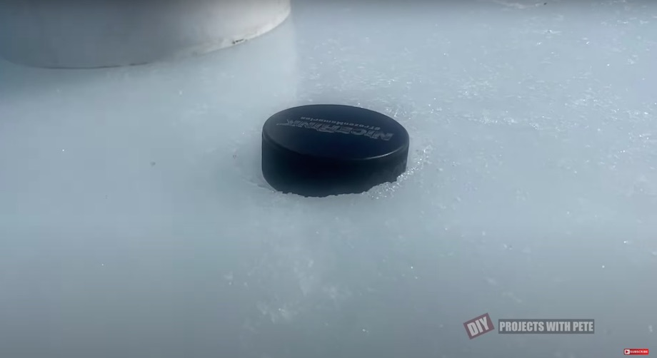 Hockey puck melted into the ice