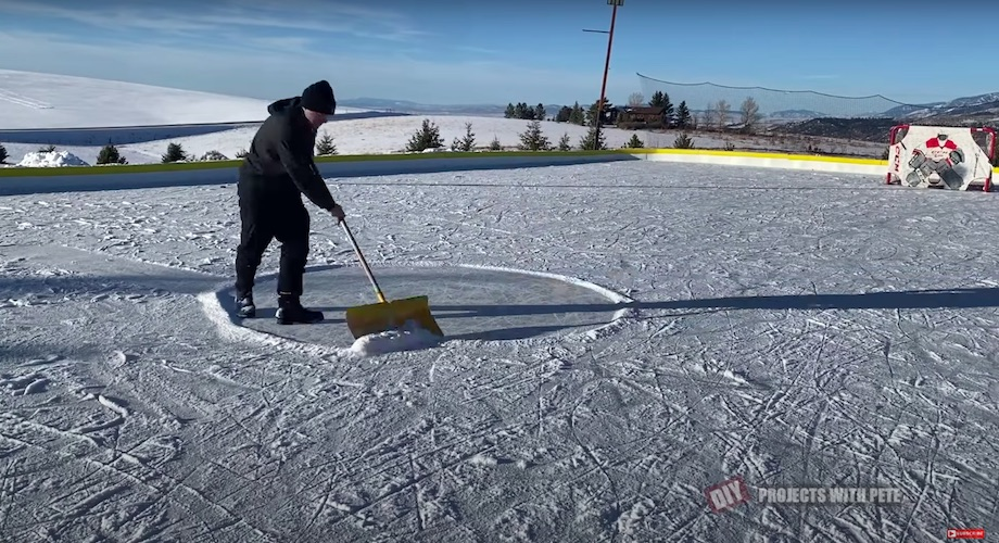Shoveling the outdoor ice rink often